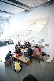 picnic office design. A Group Of Young Adults Sit Around An Indoor Picnic Table With Canvas Srchitectural Floorplan Office Design M