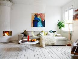 rustic apartment design vintage laminate flooring neutral colored sofas white painted walls with abstrac painting rounded white coffee table