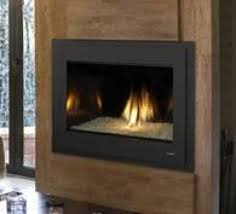 this modern model evolved from the most award winning gas fireplace series ever made artistic flames rise through crushed glass radiating within a