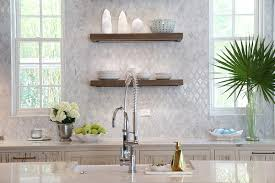 cypress kitchen cabinets with marble diamond pattern tiles