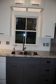 would like a suggestion on a grout color for this glass tile color light grey optimus reflections 1 glass tile rain kitchen cabinets are white
