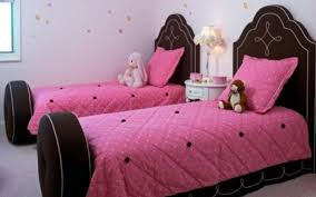 brown wooden twin bed frame for girl with pink