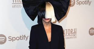 sia reveals her wig less face as she poses up a storm with katy perry and missy elliot mirror