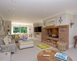 modern living room with brick fireplace. This Is An Example Of A Classic Open Plan Living Room In London With Grey Walls Modern Brick Fireplace
