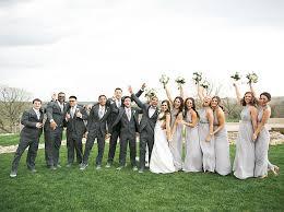 bridal party posing in vineyard