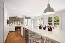 Contemporary Kitchen With Flat White Cabinets, Long Island With Calacatta  Vagli Marble And Bamboo Floors
