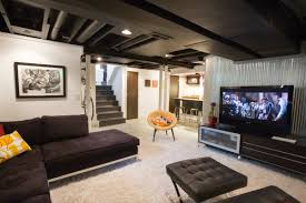 Exposed ceiling lighting basement industrial black Ideas Partially Finishing Your Basement Can Offer Warmth Style And Comfort As Well As That Extra Space Youre Craving Here Is How To Get The Most Out Of An Coldwell Banker Blue Matter How To Partially Finish Your Basement On Budget Coldwell Banker