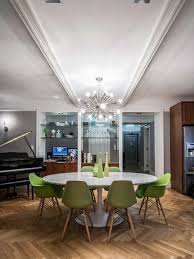 inspiration for a large contemporary um tone wood floor dining room remodel in new york with