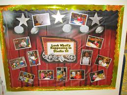 this bulletin board with a red curtain and lights backdrop is located outside our clroom as a way for other students and visitors in the to see