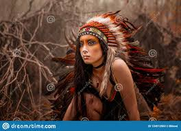 indian woman in traditional dress posing in the wild forest