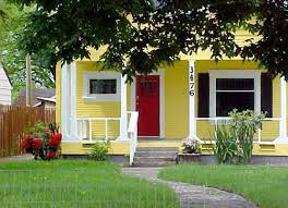 its going to have to be bigger than this but its going to be yellow with a red door and black shutters