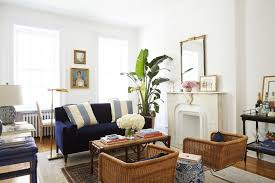amy stone s brooklyn living room featuring wicker chairs and a small velvet sofa
