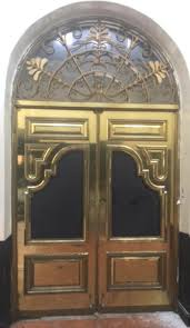 brass doors with arch