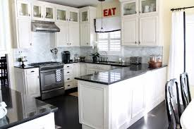 white kitchen cabinets with black countertops. Modren With Stunning White Kitchen Cabinets With Black Countertops And Chairs On