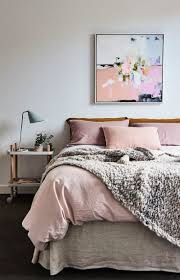 Dusty rose bedroom, with cozy chunky knit throw. Love the abstract art  piece above
