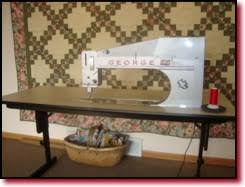 APQS Sit Down Longarm Quilting All Beefed Up! | MANQUILTER.COM & APQS George Sit Down Quilting Machine Adamdwight.com