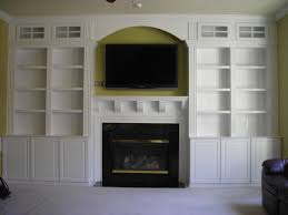 modern white wooden bookshelves and fireplace bined wall mounted