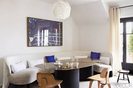 in the dining room of a duplex apartment with panoramic views of paris interior designer banquette dining room furniture