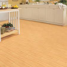 light brown no gap floating vinyl plank flooring over concrete for small living room with oak wood cabinet painted with white color and island with storage