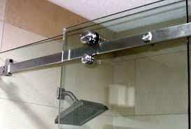 image of frameless sliding glass shower doors off the track