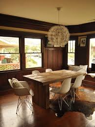 mid century eames style chairs in a rustic modern setting 3