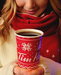 tim hortons annual to go holiday cups have arrived newly dressed for the season and for the first time featuring a celebratory hash warmwishes
