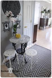 ballard design chevron zigzag indoor outdoor rug and marble iron bistro table