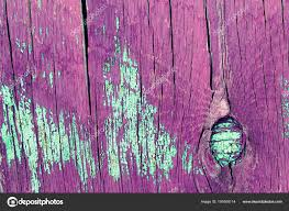 old wooden background with remains of pieces of ss of old paint on wood texture of an old tree board with paint vintage background ling paint old
