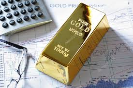 Gold Bullion Barr On A Stocks And Shares Chart Stock Photo