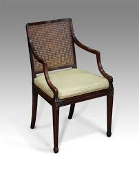 antique caned arm chair