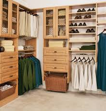 brown wooden walk in closet with drawers and glass doors also stainless steel hooks