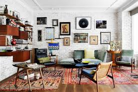 view in gallery vivacious eclectic living room with a fabulous brick wall backdrop design mikel irastorza