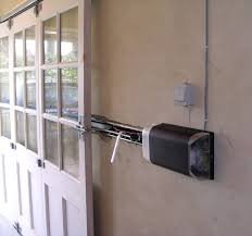 seip electric door operator with an extended track mounted on the side