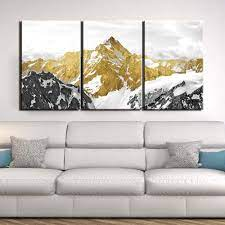 Rated 5 out of 5 by niki from perfect fit wanted something other than another square or rectangle, flat picture on my wall and these fit perfectly. 3 Piece Golden Mountain Landscape Canvas Wall Art Decorzee