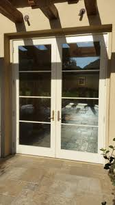large expansive sliding glass doors can sometimes pass across the secondary stationary glass panel causing the metal to s across the bowing glass