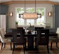 large dining room chandelier with dark wood dining table and chairs