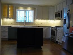 White Kitchen Cabinets Illuminated With Led Under Cabinet Lights