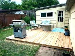floating deck over concrete patio build a footings building raised o