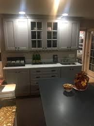 grey display with white quartz countertops