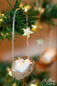 This DIY rustic homemade walnut shell manger Christmas ornament can be made  by kids, teens