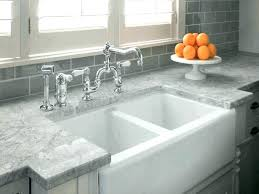 white and grey quartz countertops dark gray exposed dark grey brick wall modern square white basin