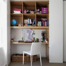 storage furniture for small spaces. brown shelving unit and white chair storage furniture for small spaces