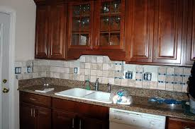 Kitchen countertop and backsplash ideas Black Granite Granite Countertops With Porcelain Tile Backsplash Passenger Ship Safety Kitchen Countertops And Backsplashes Ideas