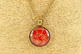 round red gold flower pendant kikulu