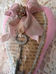 book page made into valentine with key broach ribbon and glittered edges i