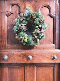 wreath on front door antique wooden door holiday wreath merry xmas merry happy new year festive holiday decorations