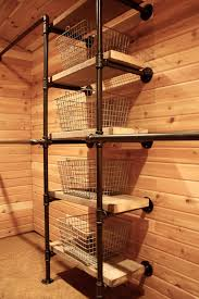 Industrial Pipe Closet System - using salvaged boards for the shelves and  vintage wire locker baskets