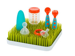 the boon green grass countertop drying rack features a bottom tray