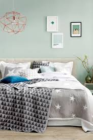mint, watery blue/green walls, grey accents, comfy bed,i like
