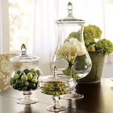 Apothecary Jar Ideas: OCD payed off, this is the look I want for the  Anniversary party! The 1 w/cluster of flowers. Add gold bow to top of lid.